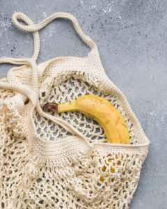 banana on white knit bag
